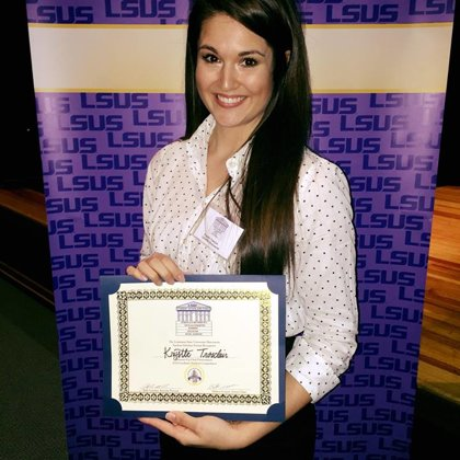 Krystle and her 2nd place prize for her talk at the LSUS Scholars Symposium (March, 2017)